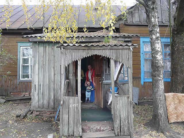 Sponsored children in wooden house